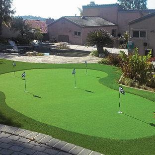 Photo of a large mediterranean full sun backyard stone landscaping in Orange County.