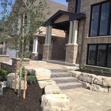 Traditional Landscape by Platinum Stone Design Inc