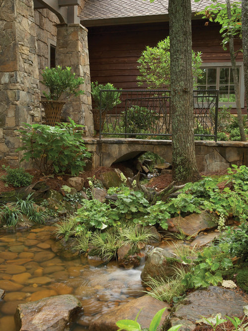 River Rock Design Ideas view in gallery Inspiration For A Traditional Landscape In Atlanta With A Water Feature