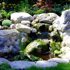 Contemporary Landscape by Swick's Organic Landscaping