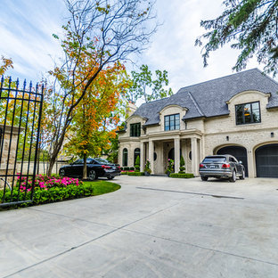 This is an example of a large traditional full sun front yard landscaping in Toronto for summer.