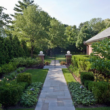 Traditional Landscape by Earth Developments, Inc.