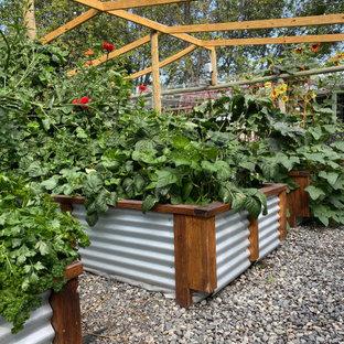 Inspiration for a farmhouse full sun river rock vegetable garden landscape in Other.