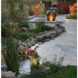 This is an example of a mid-sized modern full sun backyard stone water fountain landscape in San Francisco.