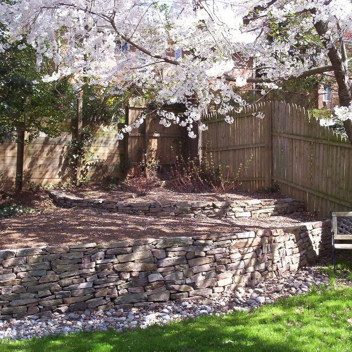 Back yard retaining wall before and after