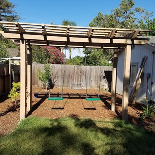 Inspiration for a mid-sized traditional partial sun backyard outdoor playset in Orange County.