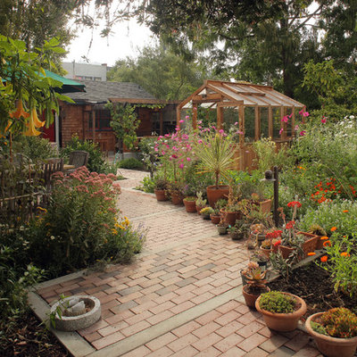This is an example of a large rustic full sun backyard brick garden path in San Francisco.