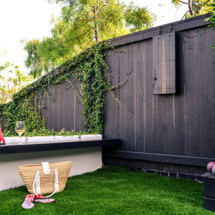 Design ideas for a huge mediterranean drought-tolerant and partial sun side yard outdoor playset in Los Angeles with decking.