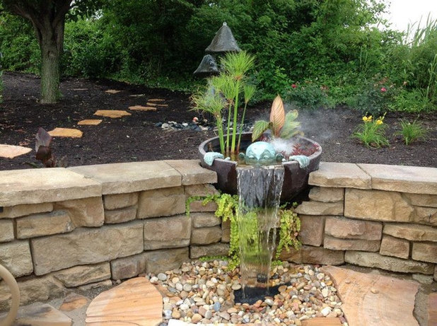 Traditional Landscape by H2O Designs