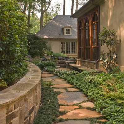 Inspiration for a traditional shade side yard water fountain landscape in Atlanta.