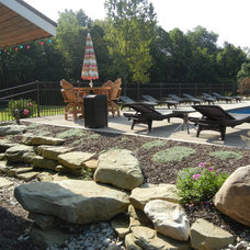 Traditional Landscape by Warrens Landscaping