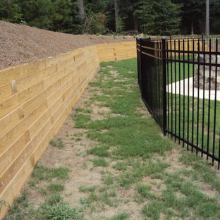 Photo of a large traditional backyard garden in Atlanta with a retaining wall.