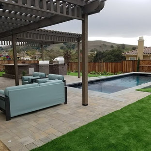 This is an example of a mid-sized traditional partial sun backyard concrete paver pond in San Francisco.