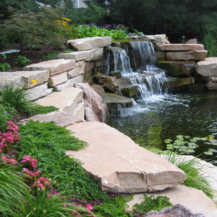 Photo of a large transitional partial sun courtyard pond in Omaha for summer.