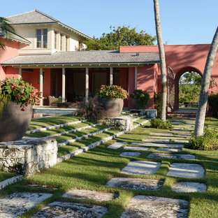 This is an example of a tropical backyard landscaping in Miami.
