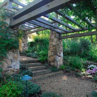 Photo of a huge traditional shade hillside gravel formal garden in Charlotte for spring.