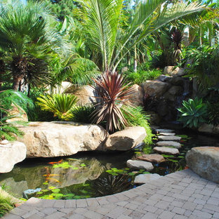 Inspiration for a contemporary brick pond in San Diego.