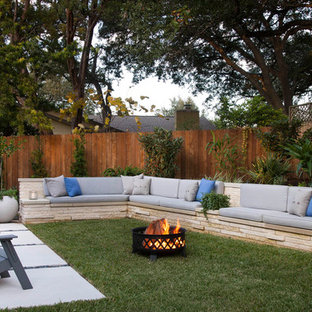 Photo of a transitional partial sun backyard landscaping in Austin with a fire pit.