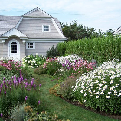 This is an example of a coastal full sun backyard formal garden in New York for summer.