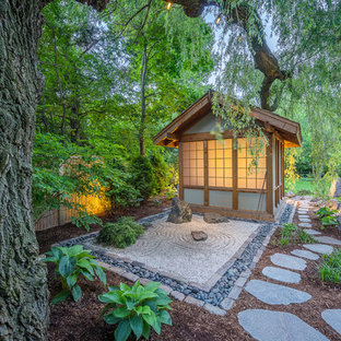 Inspiration for a large asian partial sun backyard stone garden path in Milwaukee.
