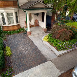 Inspiration for a small modern partial sun front yard brick driveway in Toronto for summer.