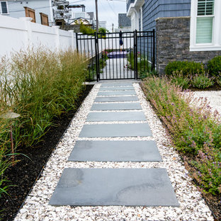 Inspiration for a mid-sized coastal front yard stone landscaping in Boston.