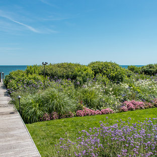 Photo of a coastal backyard garden path in New York with decking.