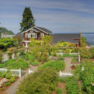 Photo of a large beach style full sun front yard gravel landscaping in Seattle.