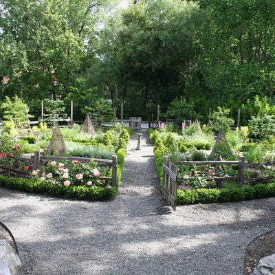 Photo of a large eclectic partial sun backyard gravel vegetable garden landscape in San Francisco for summer.