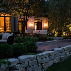 Traditional Landscape by Bruss Landscaping, Inc.