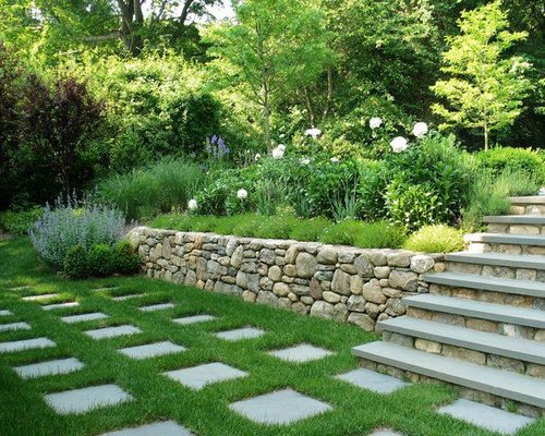 75 Por Garden with Natural Stone Pavers and a Retaining Wall ... Wall Garden Design Pavers on rock garden wall designs, wood garden wall designs, stone garden wall designs, landscape pavers designs, outdoor block wall designs, brick wall designs, beautiful landscape designs,