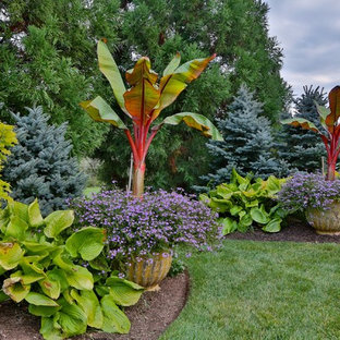 Design ideas for a large traditional backyard formal garden in New York.
