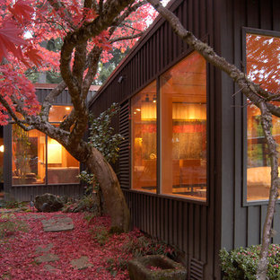 This is an example of a mid-sized contemporary backyard landscaping in Portland for fall.