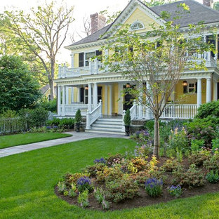 This is an example of a traditional front yard landscaping in New York.
