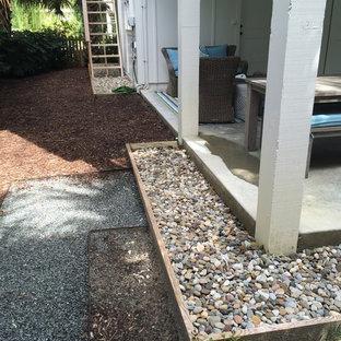 Design ideas for a small beach style partial sun stone formal garden in Wilmington.