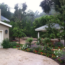 Traditional Landscape by Addition Building & Design, Inc.