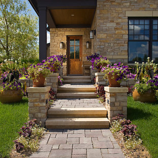 Mid-sized arts and crafts front yard partial sun formal garden in Orange County with a container garden and natural stone pavers for summer.