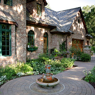 Photo of a large traditional front yard brick garden path in Minneapolis.