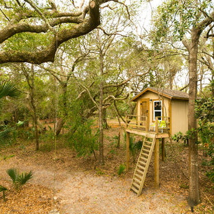This is an example of a rustic backyard outdoor playset in Charleston.