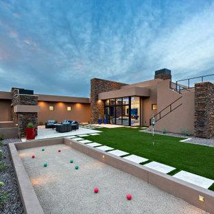 Photo of a contemporary full sun backyard gravel outdoor sport court in Phoenix.
