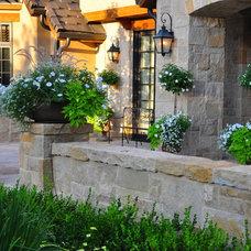 Traditional Landscape by Designscapes Colorado Inc.