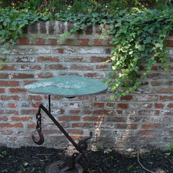 Bird baths made from recycled auto glass -