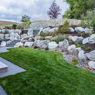 This is an example of a small transitional backyard retaining wall landscape in Seattle.