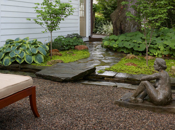 Patio of the week koi glide around a tranquil garden 39 s moat for Tranquil garden designs