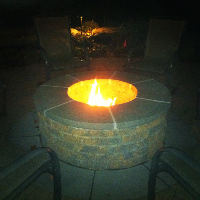 bluestone firepit with surrounding landscape design
