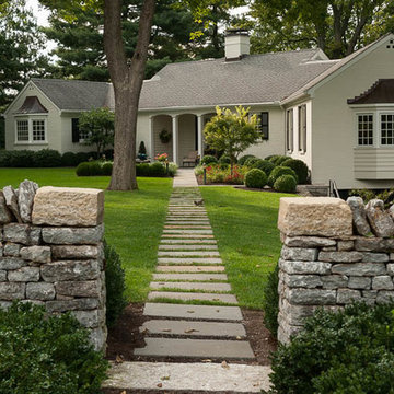 Bluestone step stone path pierces limestone wall and  transitions to solid blues