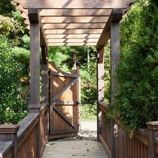 This is an example of a mid-sized traditional backyard garden path in Other with decking.