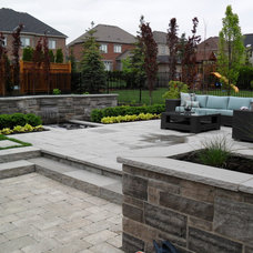 Traditional Landscape by The Landscape Company Inc..