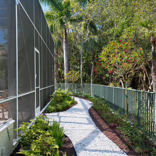 Inspiration for a tropical shade backyard garden path in Miami.