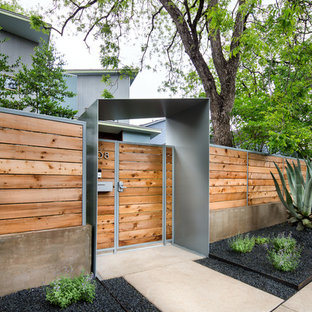 Design ideas for a mid-sized contemporary full sun and drought-tolerant front yard concrete paver garden path in Austin.